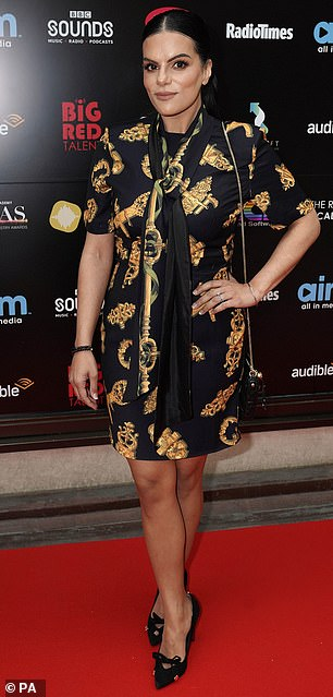 Silky: Neev Spencer donned an intricate black and gold dress