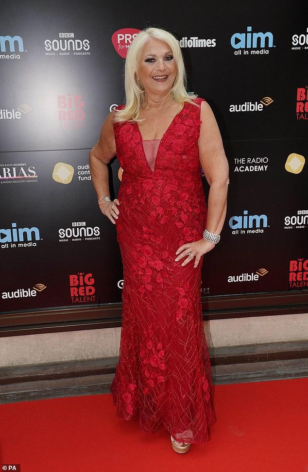 Miss scarlet: Vanessa Feltz showed off her frame in a rose-patterned red cocktail dress