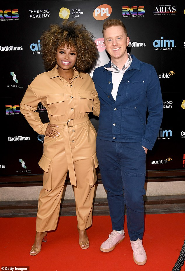 Pals:The fitness model also posed with her Hits Radio DJ James Barr who looked smart in a blue jacket and matching chinos