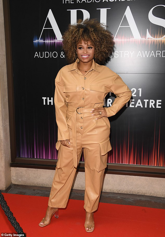 Beauty:Fleur looked great in the camel-hued jumpsuit which featured silver button detailing and was cinched in at the waist to show off her figure
