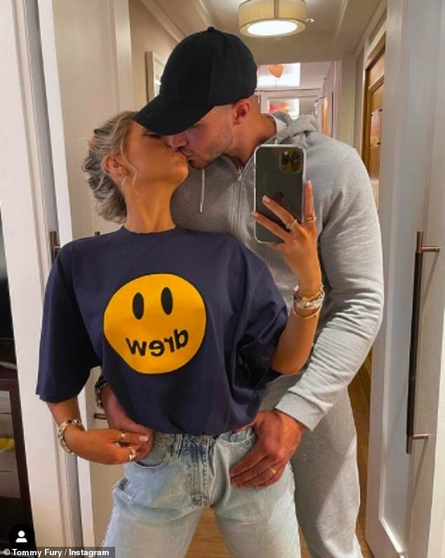 Sweet: Tommy shared another snap later in the day kissing his love as they took a picture in the mirror