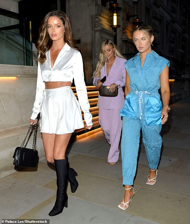 Chic:Molly-Mae's sister Zoe looked stylish in a pastel lilac trouser suit which she teamed with barely-there heels and Louis Vuitton clutch bag