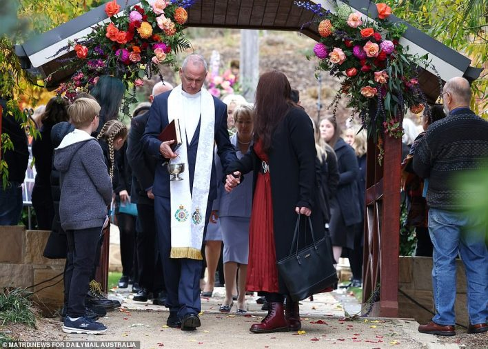 Lauren's mother looked back to ensure her daughter's casket was right behind her at the end of the ceremony