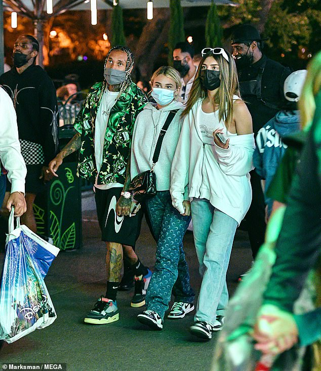 Look who it is:Tyga couldn't be missed in his eye-catching outfit, donning a green Frankenstein patterned shirt, which he paired with a white T-shirt, black shorts and funky trainers