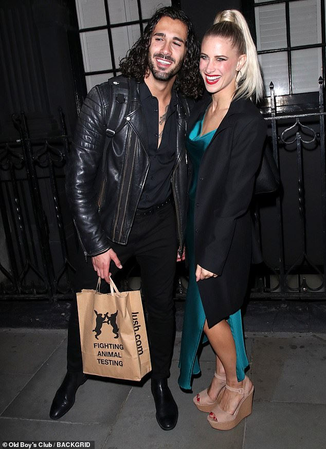 Cheerful:The Strictly Come Dancing star, 27, and his partner didn't let the new delay rain on their parade as they enjoyed the fun-filled press night in the West End