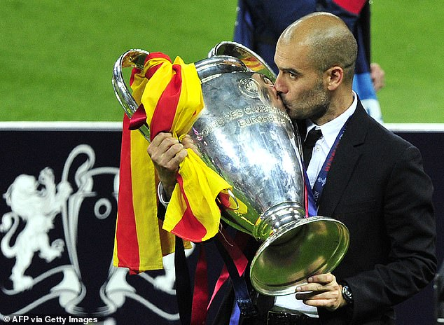 Pep Guardiola kisses the Champions League trophy after beating Manchester United in 2011