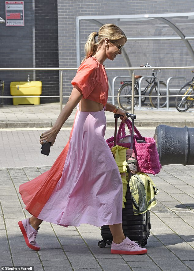 Wow: Vogue looked radiant as ever as she departed filming for the show, and she slipped into a red and pinks short-sleeved midi dress with a cut out across the midriff
