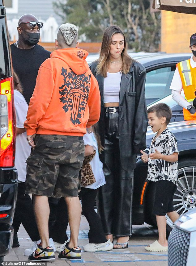 Family:The lovebirds were joined by his sons Mason, 11, and Reign, six, and daughter Penelope, eight