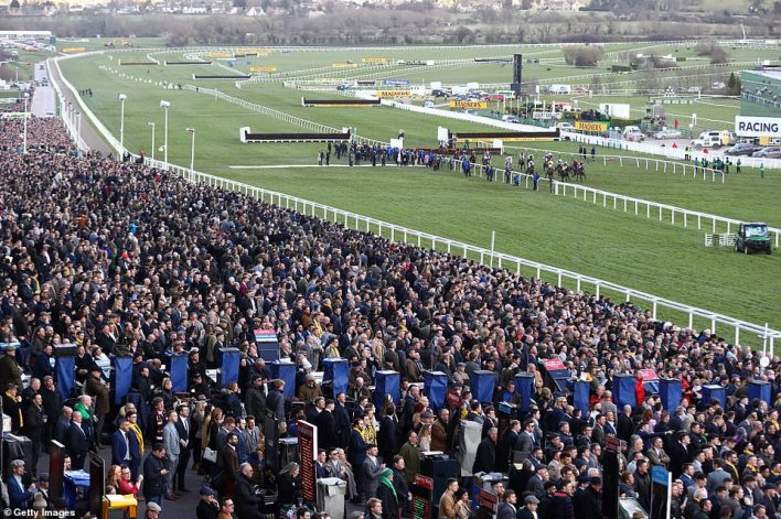 The Cheltenham Festival horse racing event went ahead on March 10, 2020, despite concerns that the virus could spread there. Pictured: A race on March 13, by which time Boris Johnson had already admitted: 'There is no hiding from the fact that the coronavirus outbreak will present significant challenges for the UK'