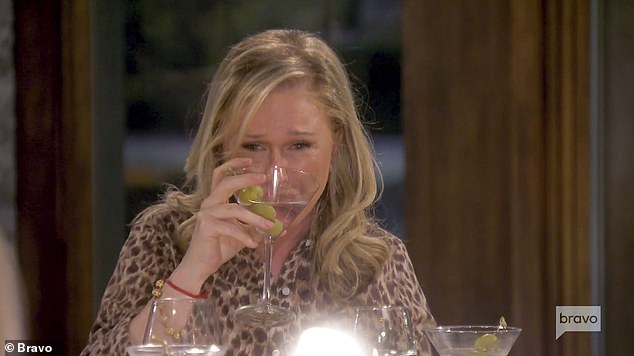Bottoms up!The clip starts with Kathy proclaiming with her third martini in her hand: 'I've already had two of these'