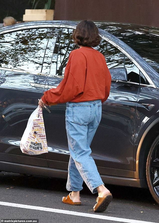 Hungry:She then picked up some takeaway from Chargrill Charlie's before leaving in her car