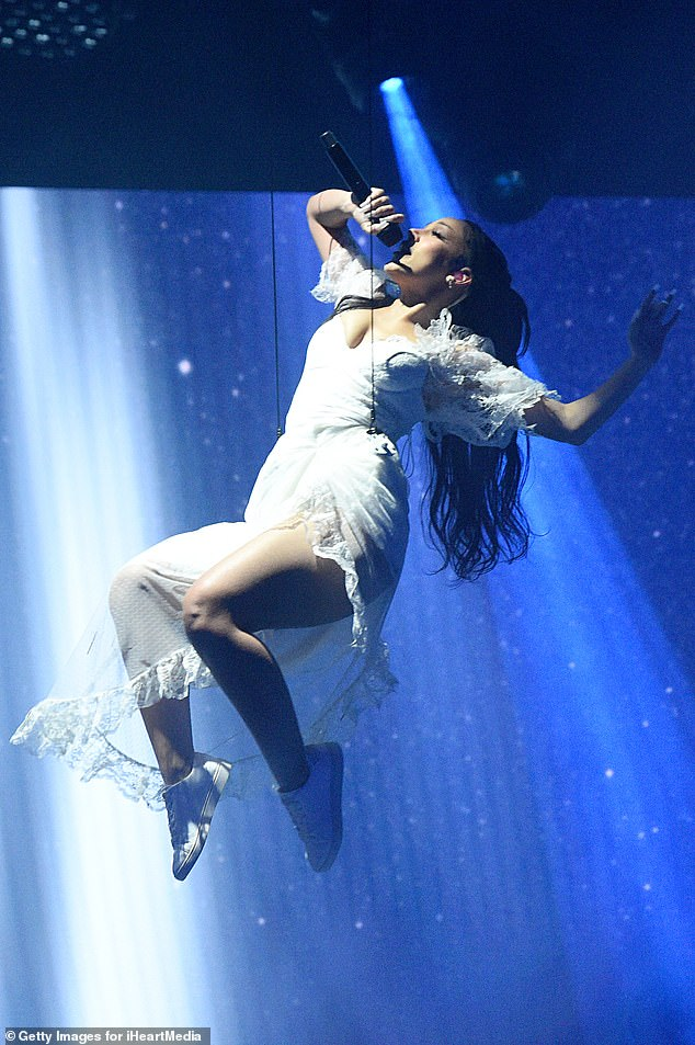 Sent from above! It comes after Doja made quite the entrance as she floated down to stage to perform at the iHeartRadio Music Awards in LA at the end of May