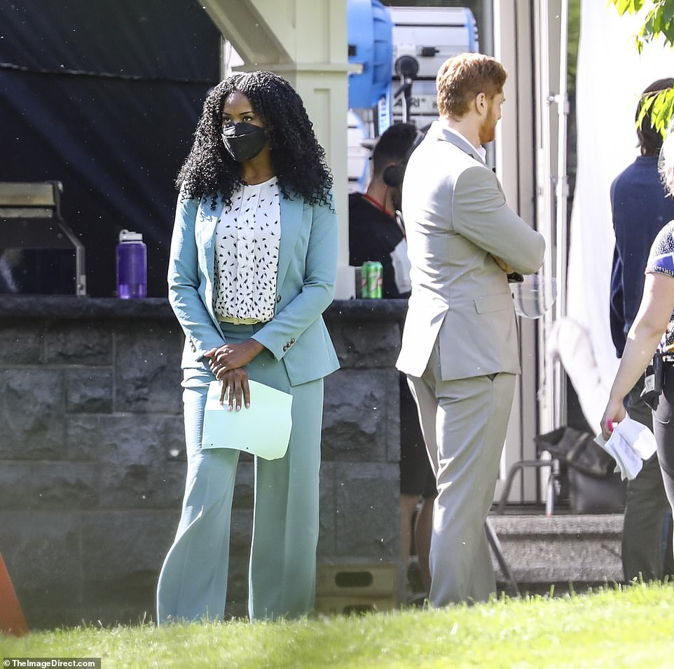 Downtime: It is not known who the elegant woman in blue is, but it is possible she is a co-star in the Lifetime movie