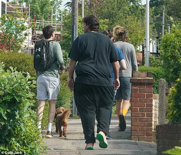On the right track: James showed off his slimmed-down frame as he walked along the street