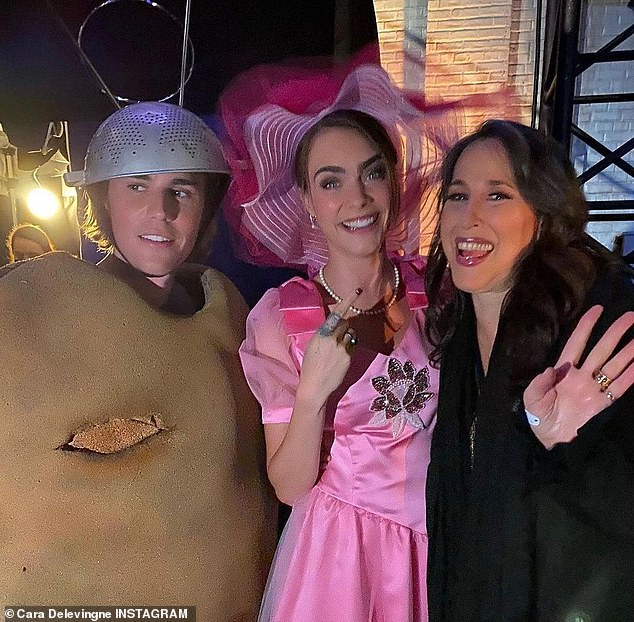 Having a laugh: Cara wore Rachel's ugly pink dress for a Friends fashion runway, while Justin wore Ross Halloween 'Spudnik' costume