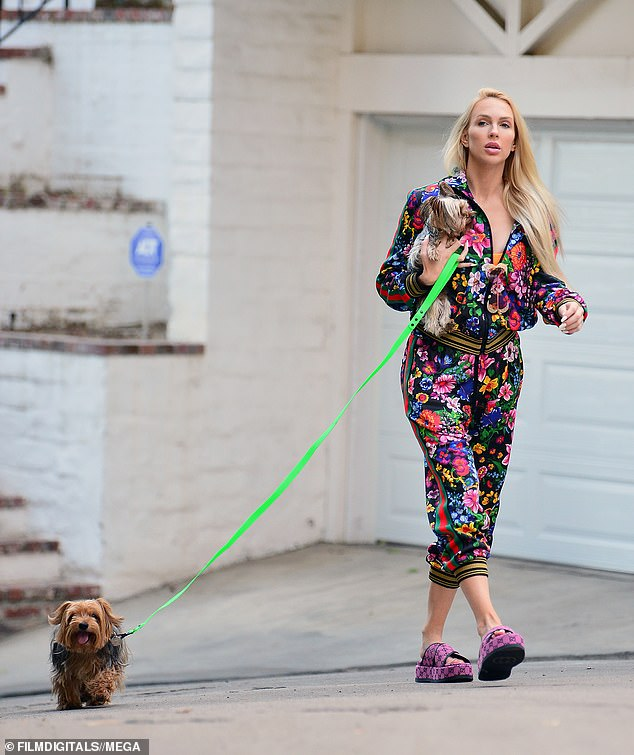 Bounce back:Christine Quinn , 31, showcased her incredible post-baby body in a Gucci tracksuit as she headed out on a dog walk on Friday, just two weeks after son Christian's birth