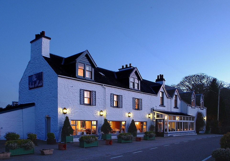 Welcoming: Inside the hotel is a cosy single-malt-minded bar, two lounges with log fires and sofas, and a restaurant