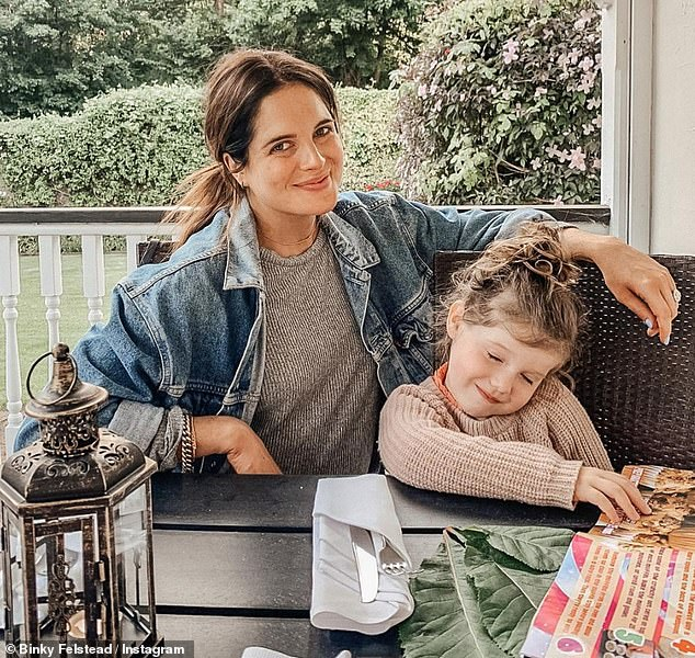 Cute: Binky shared a sweet snap with her daughter India as they celebrated their 'last weekend as a three' with Max on a staycation in Sussex