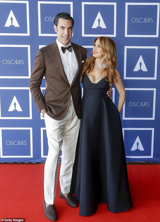 Back:A slew of Aussie have returned home over the past year, including actress Isla Fisher (right) who brought her English husband Sacha Baron Cohen (left) and their children, with her.'They didn't want to raise their kids in Trump's America,' an insider said