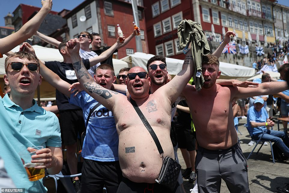 Men in shirts and others without cheer as they prepare for the first all-Engish final for years in Porto, Portugal, tonight