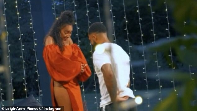 Marry me:The singer then burst into tears as the words 'Will You Marry Me' flash up on screen as Andre then gets down on one knee and proposes, presenting her with a dazzling ring