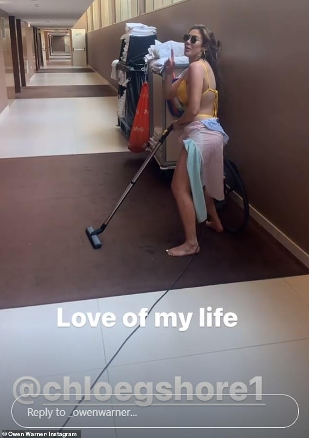 Couple? Owen also shared a video of Chloe playing around with a vacuum cleaner in a hotel lobby as he wrote: 'Love of my life'