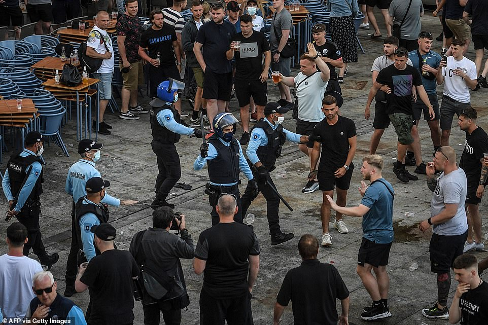 Manchester City supporters clashed with police at Ribeira in Porto on Saturday - the eve of UEFA Champions League final football match between Manchester City and Chelsea at the Dragao stadium
