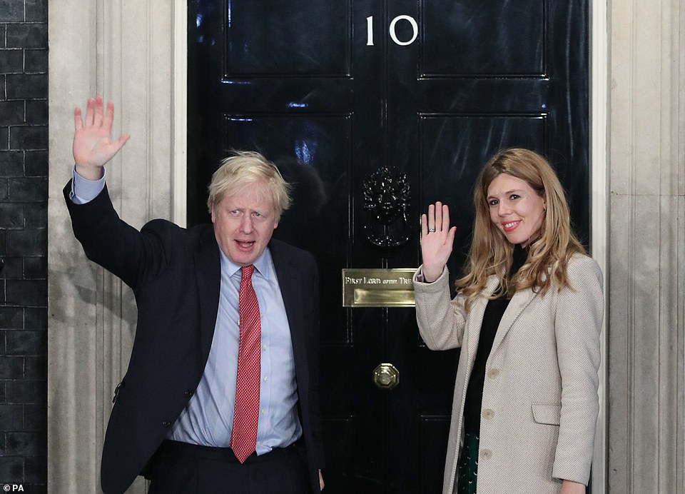 Ms Symonds waved with now-husband on the steps outside the famous black door following the Conservatives' thumping victory in 2019