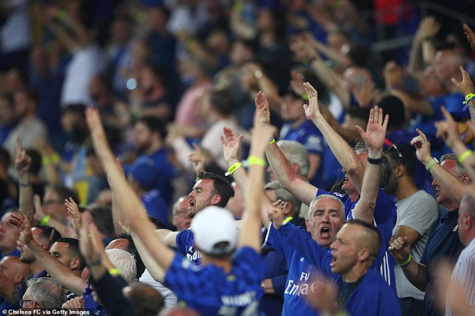 Chelsea fans in the Estadio do Dragao in Porto cheer as their team claimed the prestigious trophy, nine years after their previous triumph in the competition