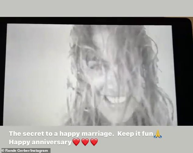 'The secret to a happy marriage': Gerber also paid tribute to his wife with a black-and-white video of her frolicking on the beach in one-piece swimsuit