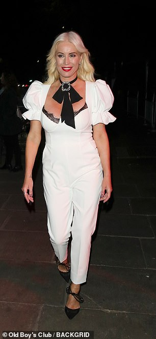 Chic: The busty ensemble featured black detailing, including a lace trim at the chest, and a pussy-bow neck tie, with a silver brooch