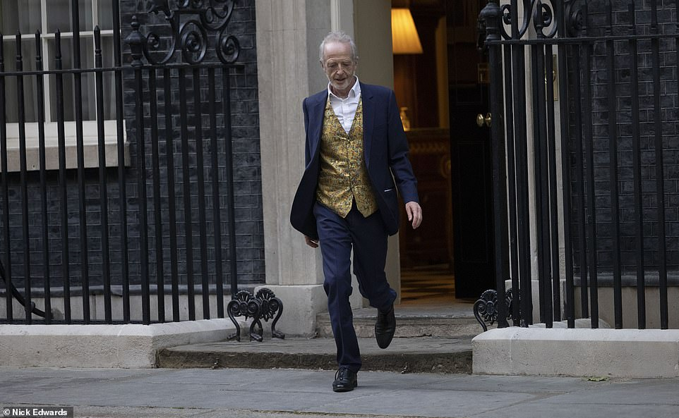 Despite sending out the cards, the couple are understood to have been secretly planning the small ceremony for six months.Pictured: A guest leaving Downing Street after the wedding. It is not clear what their relation to the newlyweds is