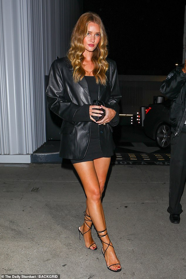 Wow:Rosie Huntington-Whiteley looked incredible as she enjoyed a dinner date with her fiancé Jason Statham at Mr Chow in Beverly Hills on Saturday