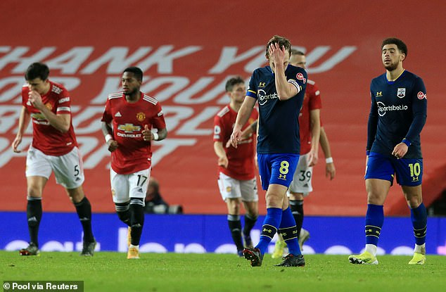 Southampton players look on in despair as United put nine goals past them in February