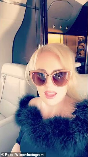 Traveling in style: The actress looked excited in selfies that she took on the plane
