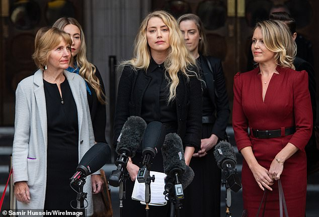 Not happening:Amber Heard is not being investigated for perjury in Johnny Depp's ongoing perjury case against her, according to her attorney. Amber is pictured with Bredehoft in July 2020