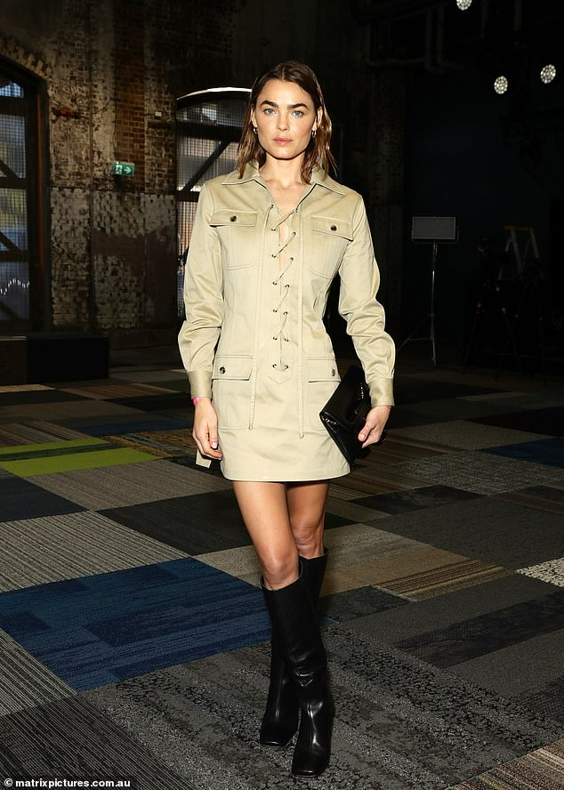 Stepping out in style: Bambi wore a camel-coloured mini dress with lace-up front detailing at the shows on Monday