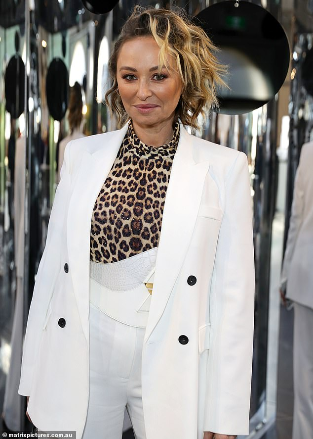 Stunning: The Celebrity Apprentice star, 44, stunned in a white tuxedo at the star-studded Afterpay Australian Fashion Week on Monday following the lifesaving operation
