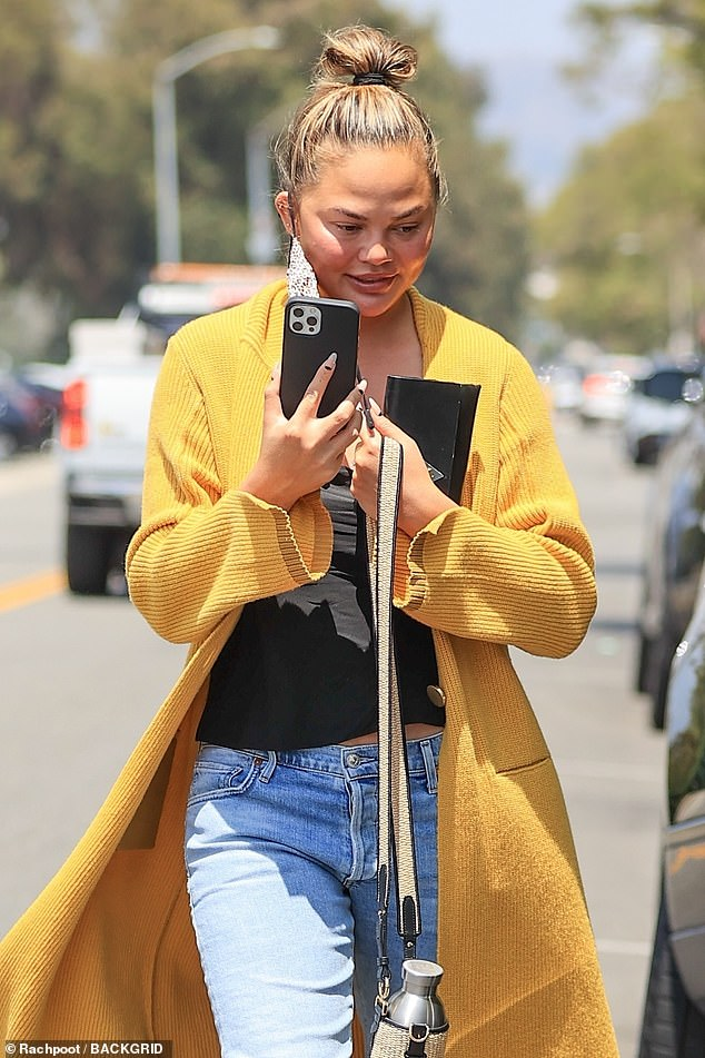 Rare spotting: Embattled model Chrissy Teigen, 35, is glimpsed for the first time in weeks amid the cyber-bullying scandal that has prompted many brands including Macy's to cut ties with her