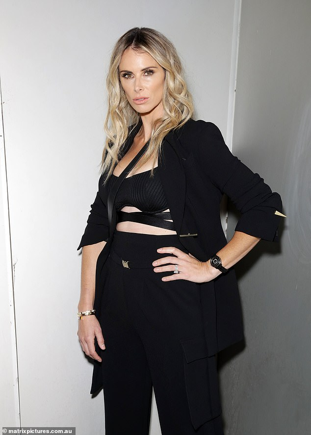 Tressed to impress: Candice wore her blonde tresses down and slightly wavy for the event, which was held at Sydney's Carriageworks for fashion week