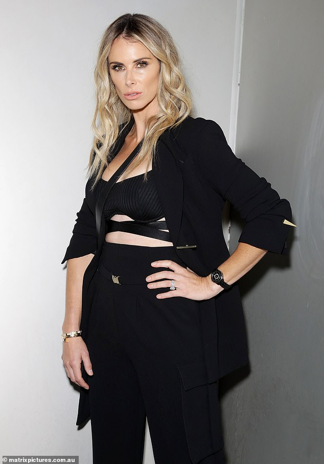 Sultry:All eyes were on Candice as she posed up a storm in the all-black ensemble, which consisted of a strappy crop top, peg-leg trousers and a slimline blazer