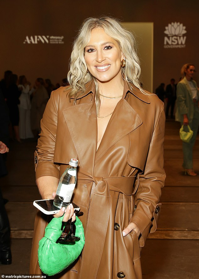 A new look:Phoebe Burgess (pictured) turned heads at Afterpay Australian Fashion Week on Monday, sporting far fuller cheeks and a more luscious pout than usual