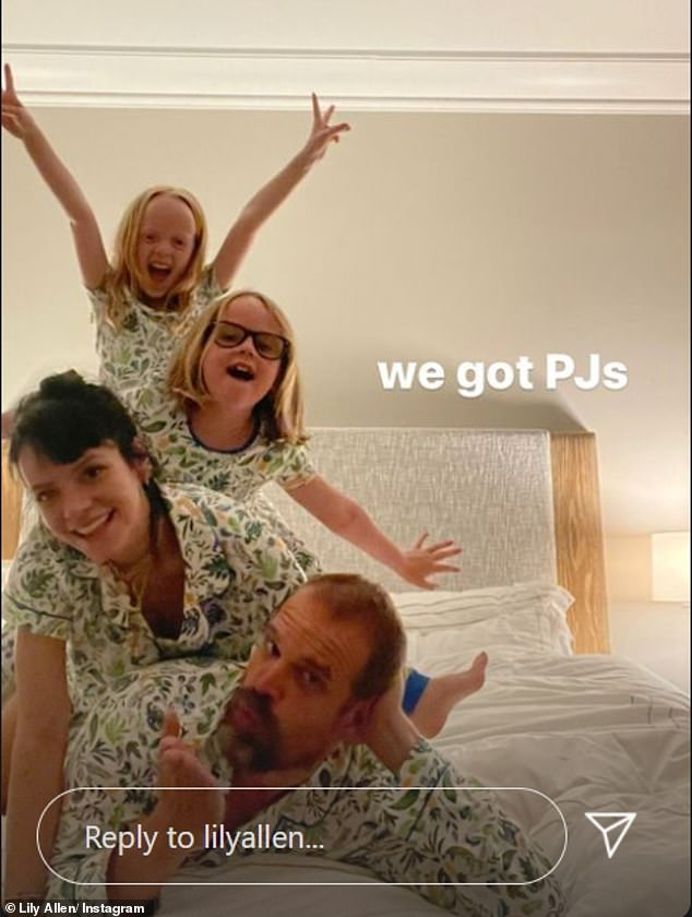 Family:The singer, 36, also shared a heartwarming snap of herself alongside her two daughters Ethel, nine, and Marnie, eight, and husband David Harbour as they posed in matching PJs
