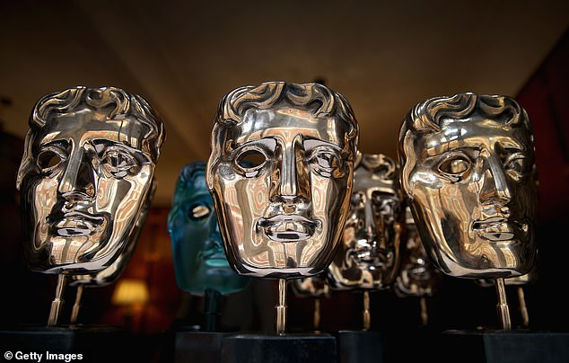 High tech guests:The BAFTA TV Awards are set to beam celebrities who can't attend Sunday's event in person onto the red carpet as holograms (pictured, a BAFTA mask gong)