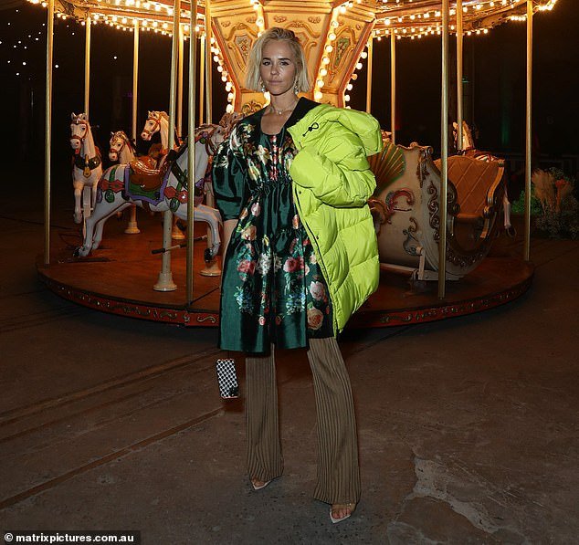 Bold look: Proving to be her brand P.E Nation's best advertisement, Pip draped the label's neon yellow puffer jacket over her shoulders while posing inside the decadent event space