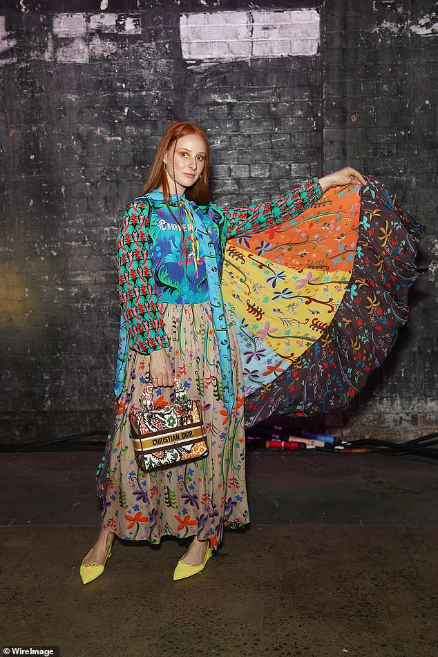 Wow!Singer Vera Blue (pictured) was a vision in a bohemian dress in a whole host of colours and artfully mismatched patterns.The frock, which featured a Cinderella theme, had a cape portion, which Vera displayed in all its splendour