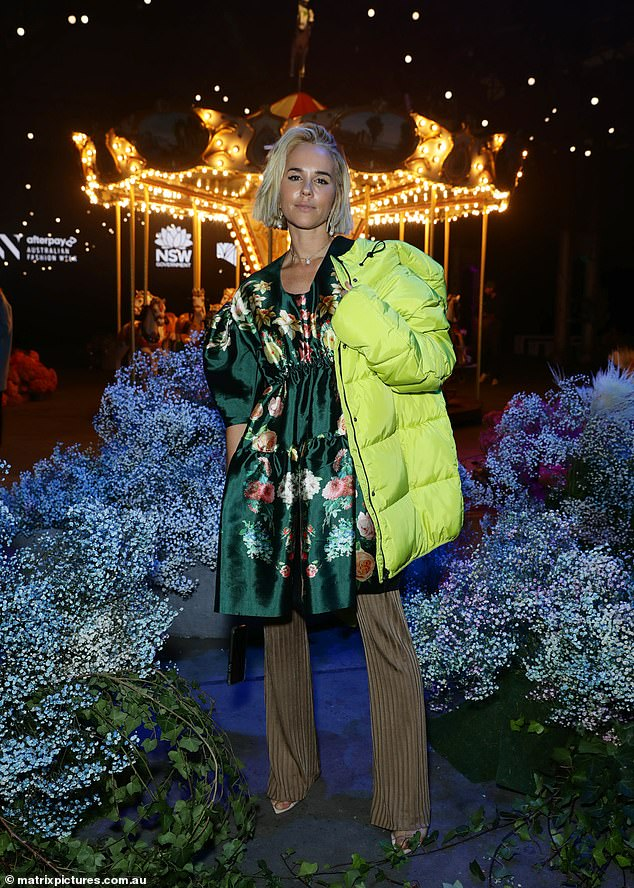 Green with envy:Pip Edwards (pictured) covered up her enviably toned figure in an emerald green floral shift dress by Romance Was Born, paired with the label's brown straight-leg pants