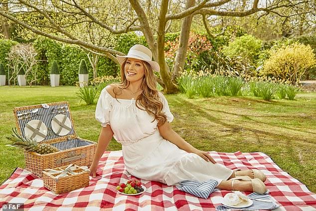 Summer sun: She was enjoying a picnic during the shoot