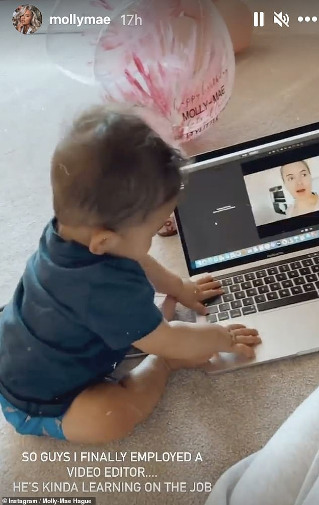 Starting him young: The blonde beauty also joked that she'd found a new video editor after Tommy's nephew played with her laptop