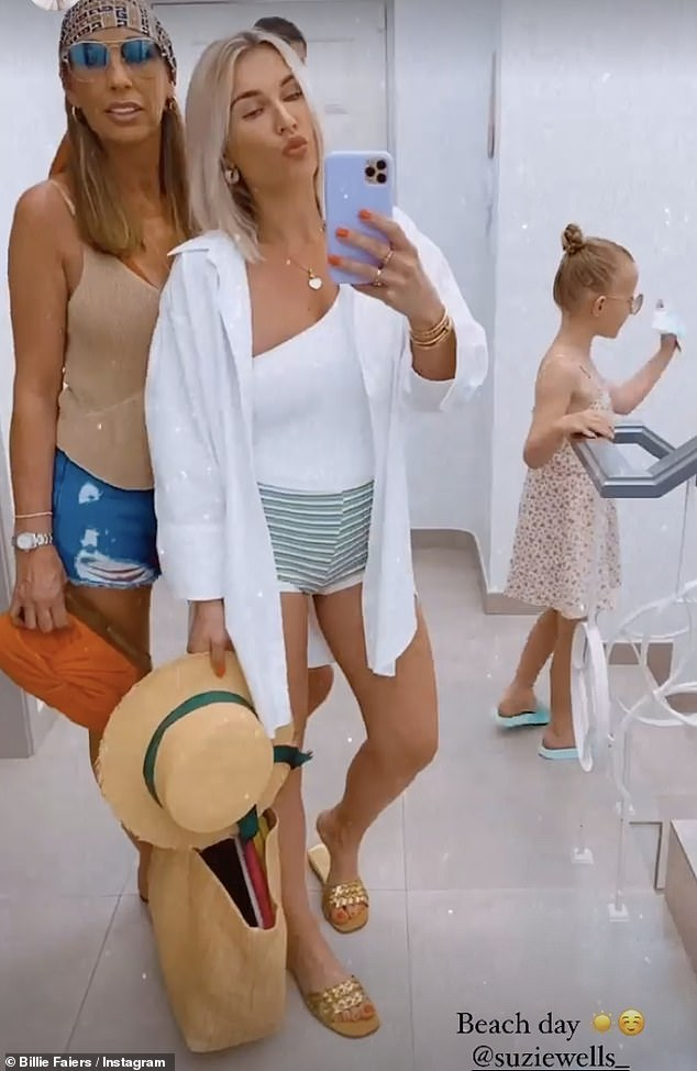 Loving life:on Sunday, Billie Faiers, 31, beamed with happiness as she cosied up to her mother Suzie during their sun-soaked family holiday in Portugal